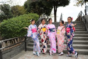 They are from Indonesia, wearing kimonos with colleagues.