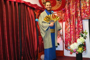 Gentleman from France wearing male Kimono, holding a Japanese stylish fan.