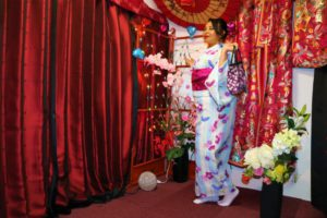 French lady wearing sky blue Kimono with purple belt.