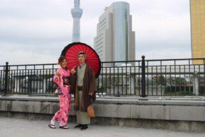 男女お二人の写真 赤、茶色の着物
